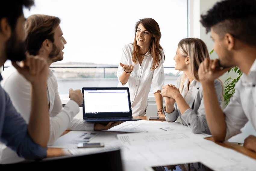 Team meeting within a company naming service operation